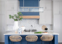 Kitchen-hood-color-matches-with-the-color-of-the-island-in-blue-217x155