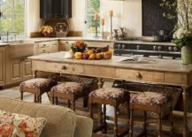 Kitchen-island-made-from-wood-that-is-same-as-the-one-used-for-the-cabinets-in-this-Mediterranean-home-217x155