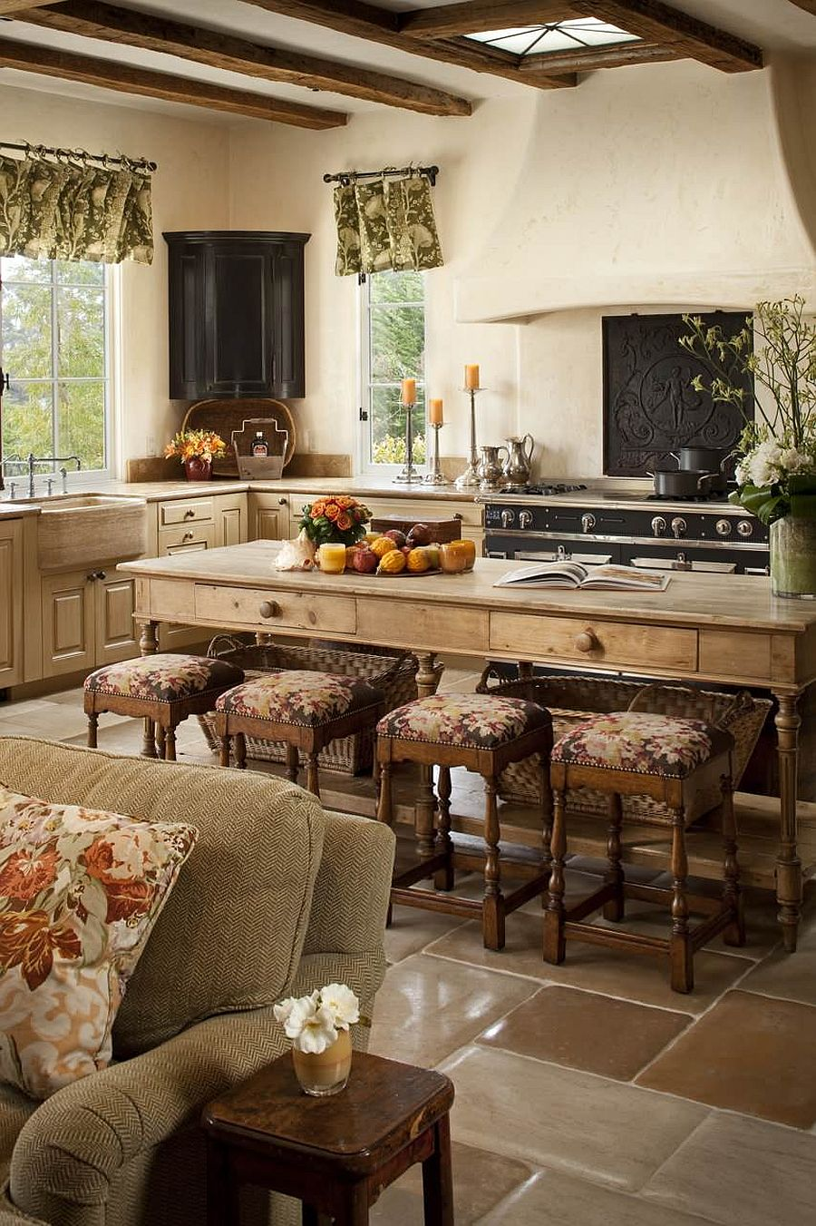Kitchen-island-made-from-wood-that-is-same-as-the-one-used-for-the-cabinets-in-this-Mediterranean-home