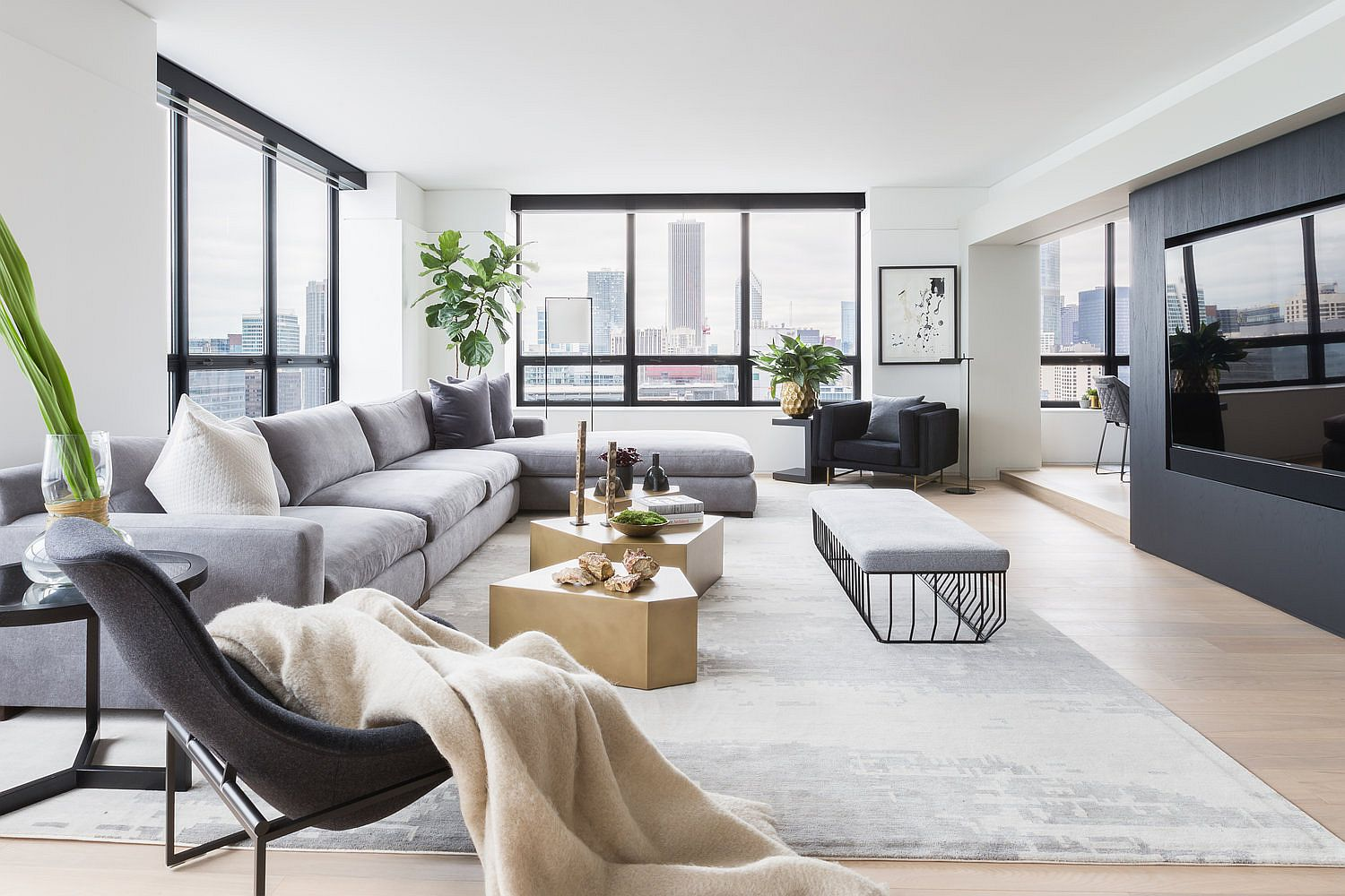 Living room of revamped Water Tower Flat in Chicago with contemporary decor
