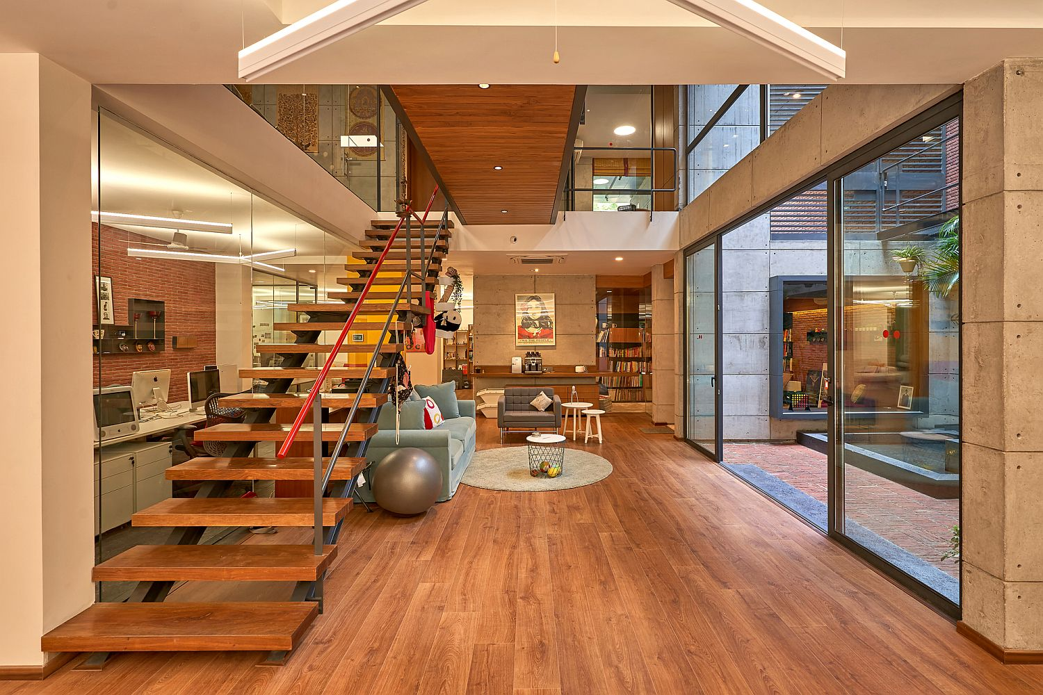 Look at the kitchen, library and other social zones inside the Lopez Design Office