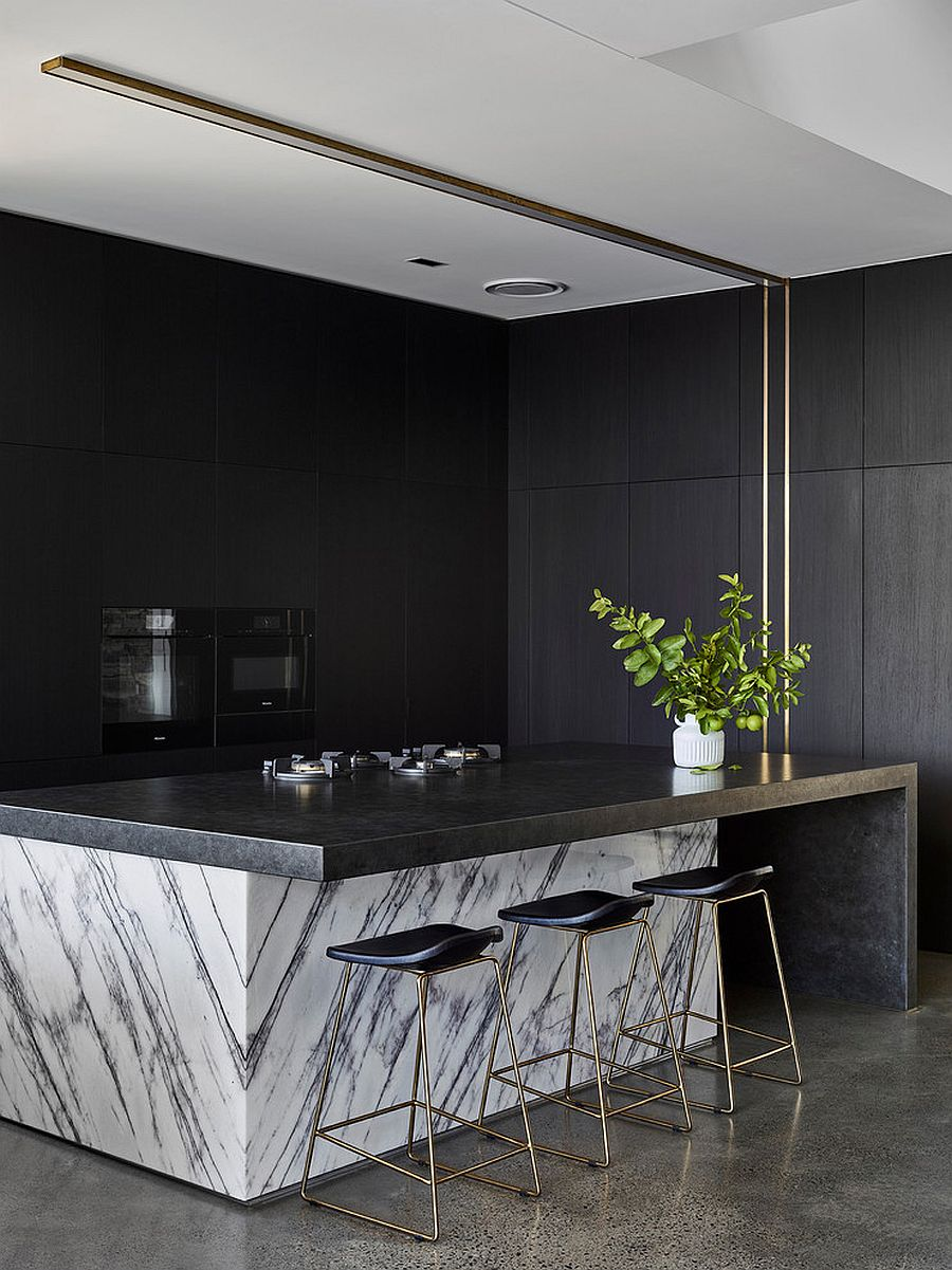 Marble-coupled-with-dark-finishes-in-the-kitchen-to-create-a-curated-look