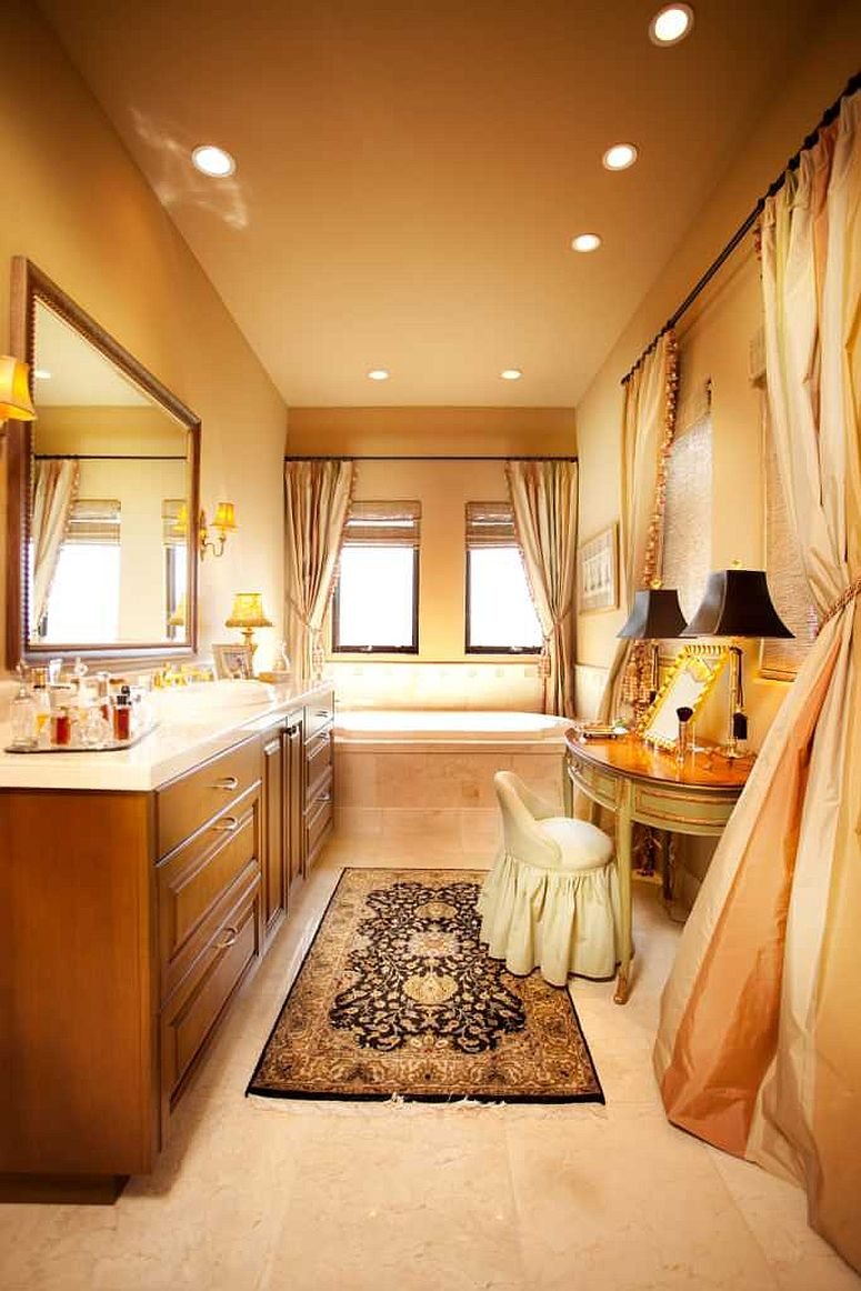 Mellow yellow for the walls of the bathroom gives it a cozier look