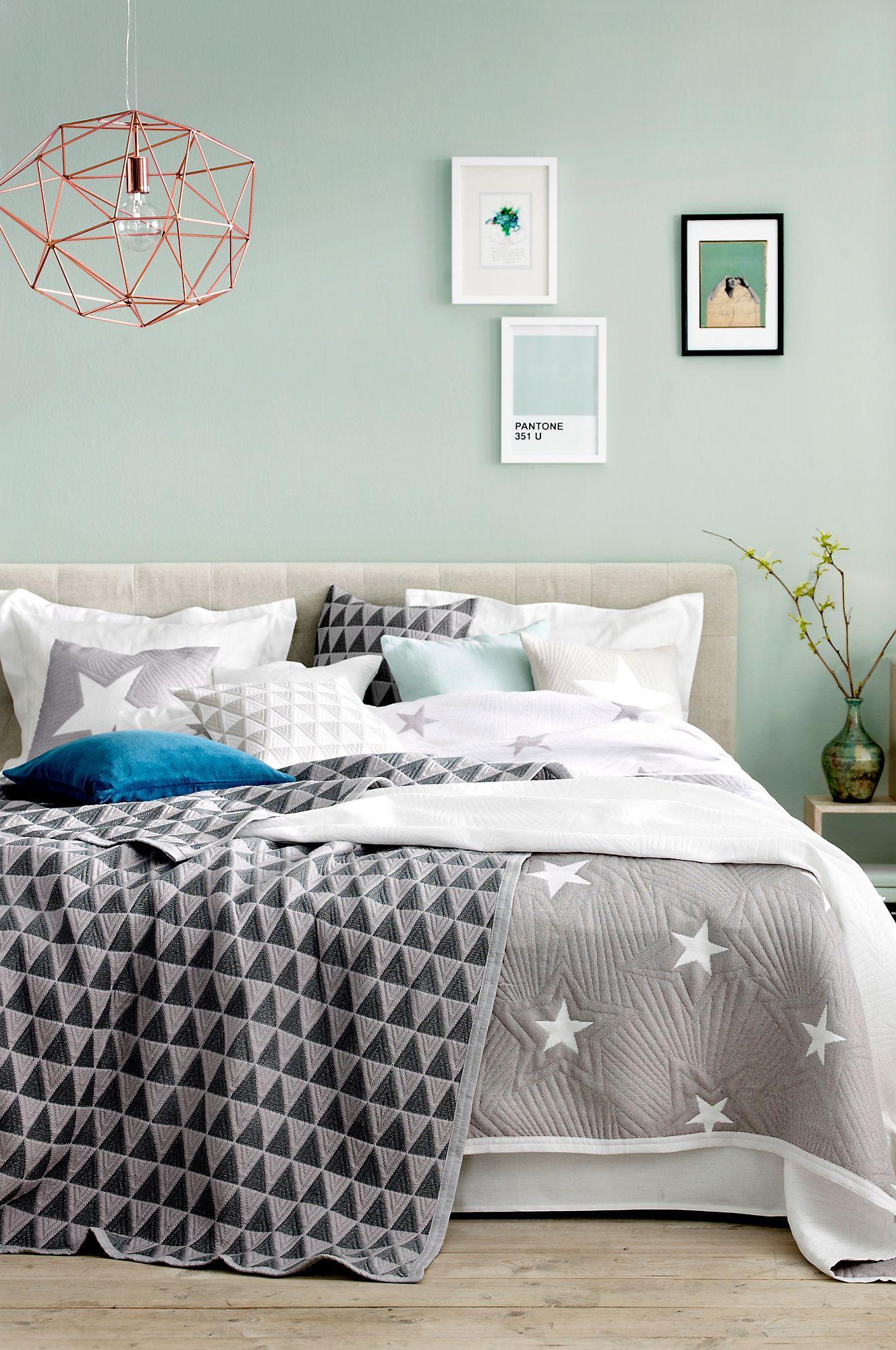 Mint green bedroom with modern fabrics