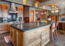 Modern-rustic-kitchen-with-an-island-that-has-ample-cabinets-and-drawers-providing-multiple-storage-options-217x155