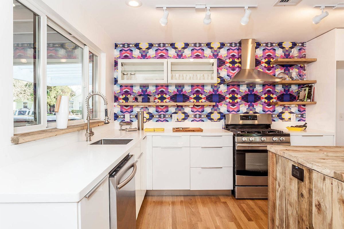 Multi-colored and bright tiled backsplash in the modern kitchen steals the show