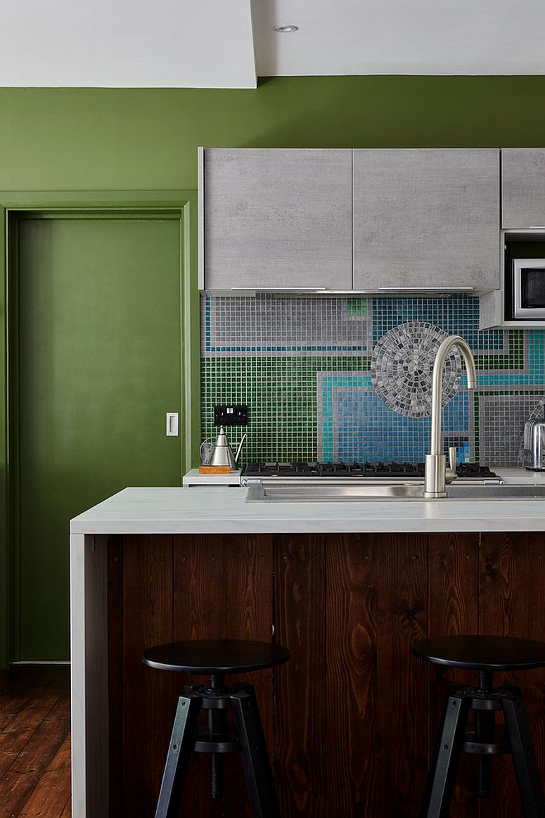 Multi-colored kitchen with tiled backsplash, woodsy island and plenty of green