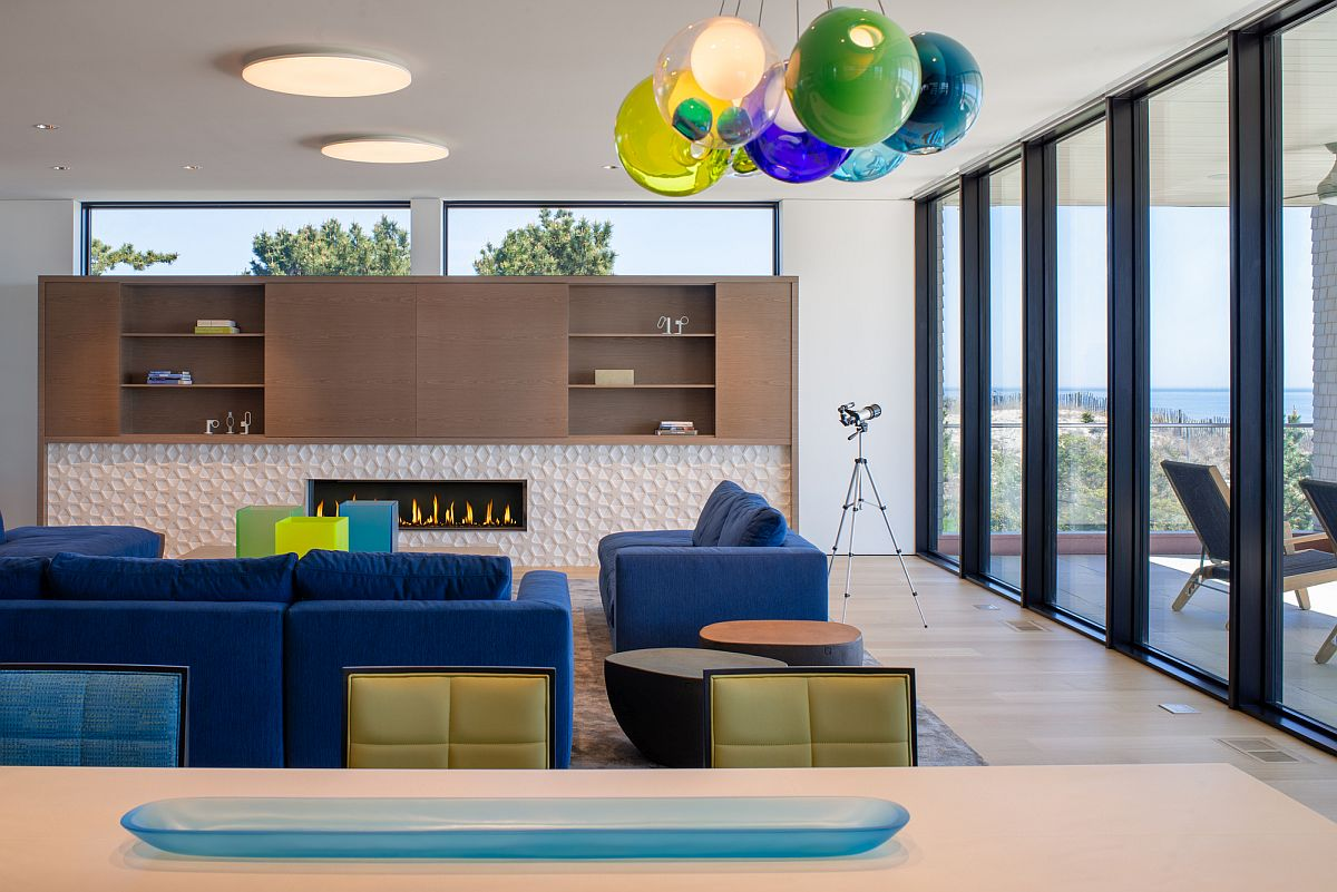 Multi-colored lighting fixtures and couch bring brightness to the living space