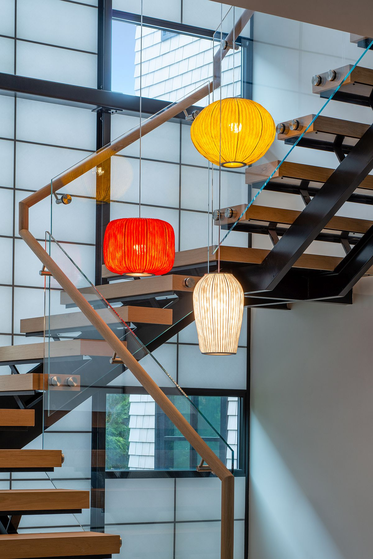 Multi-colored pendant lights for the staircase and its lightwell