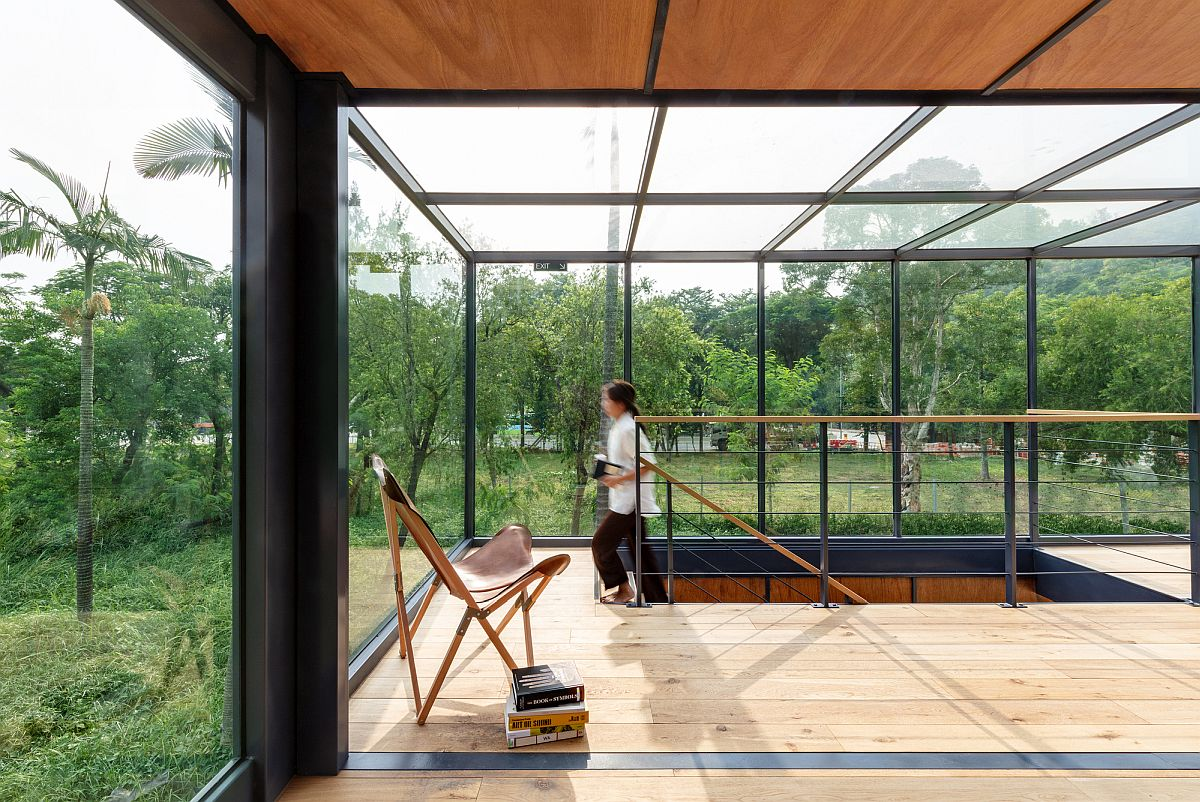 Open glass enclosures on upper level with glass ceiling that completely welcome the outdoors inside