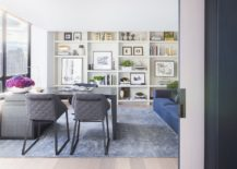 Open-shelves-with-books-wall-art-and-accessories-add-color-and-contrast-to-the-setting-217x155