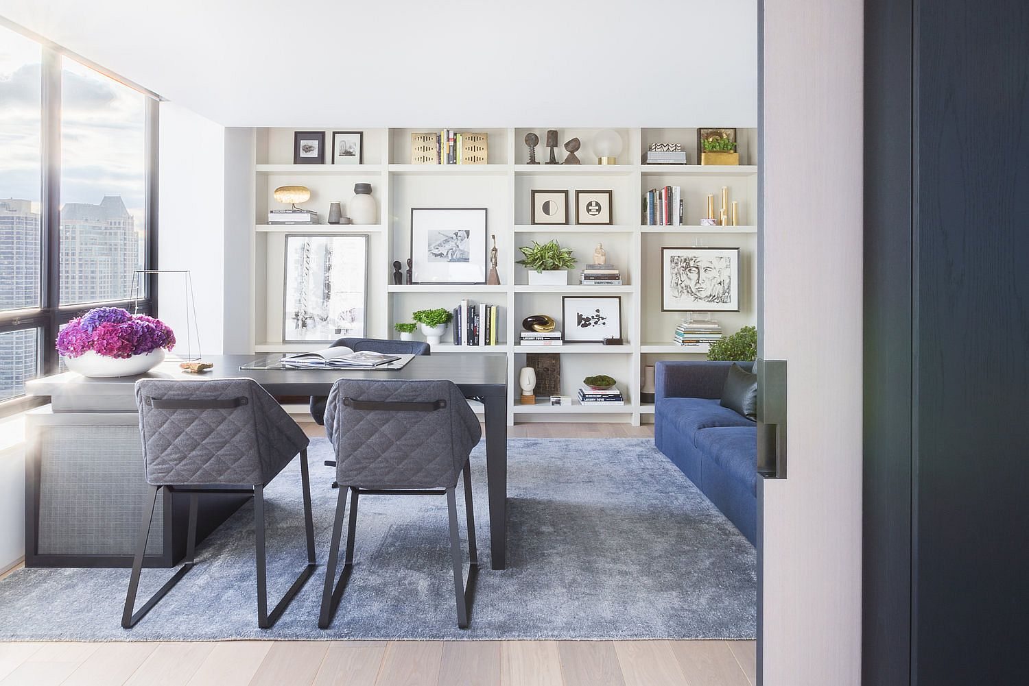 Open shelves with books, wall art and accessories add color and contrast to the setting