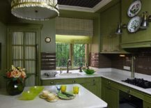 Patterned-ceiling-dark-green-cabinets-and-white-countertops-create-a-country-style-kitchen-217x155