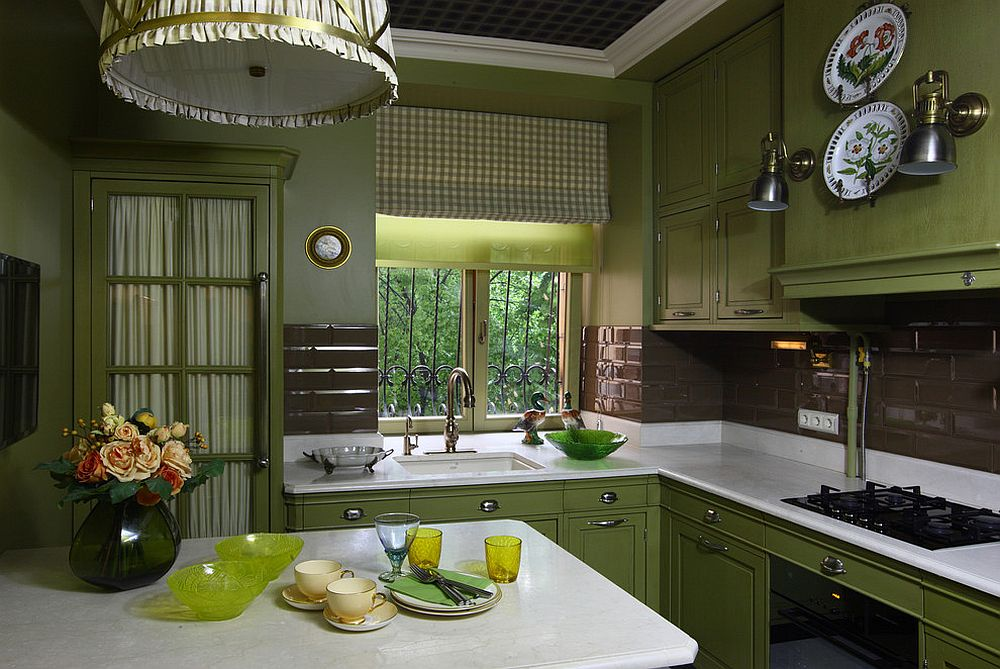 Patterned ceiling, dark green cabinets and white countertops create a country style kitchen
