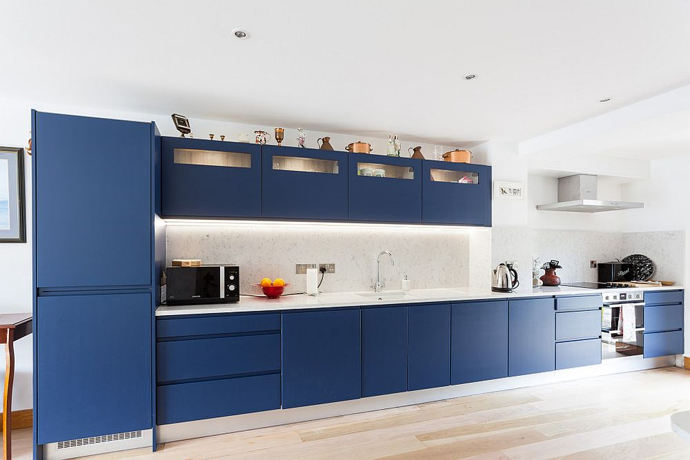 Pick a shade of deep blue along with white in the sleek, single-wall contemporary kitchen