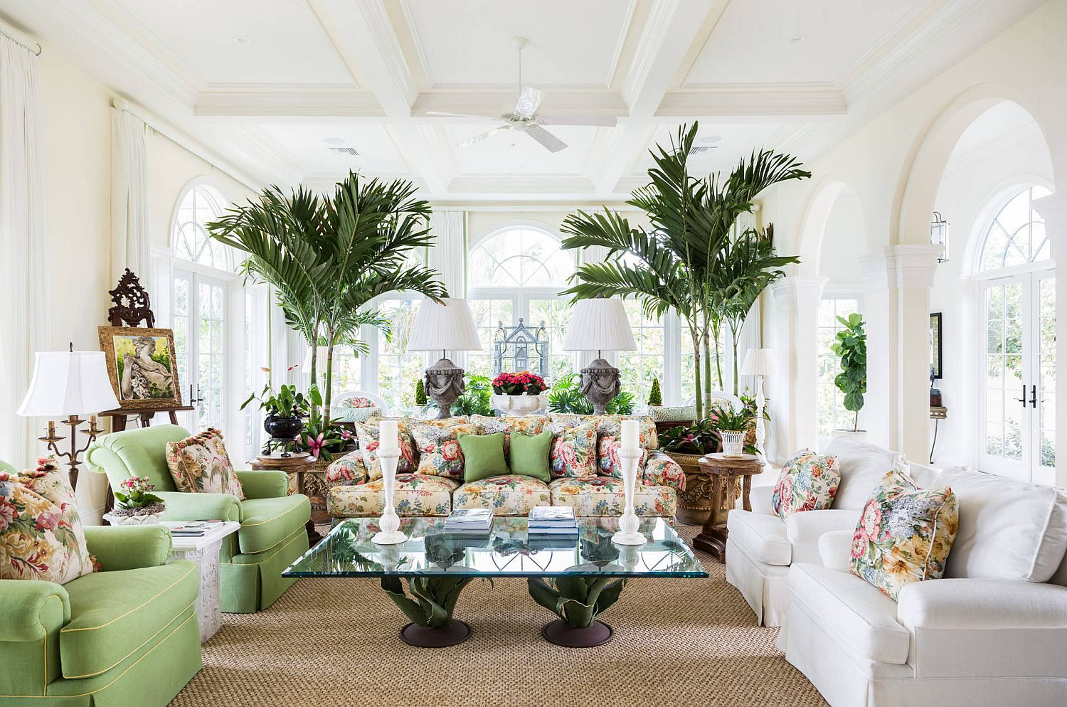 Prints and pops of color bring brightness to the white tropical style living room
