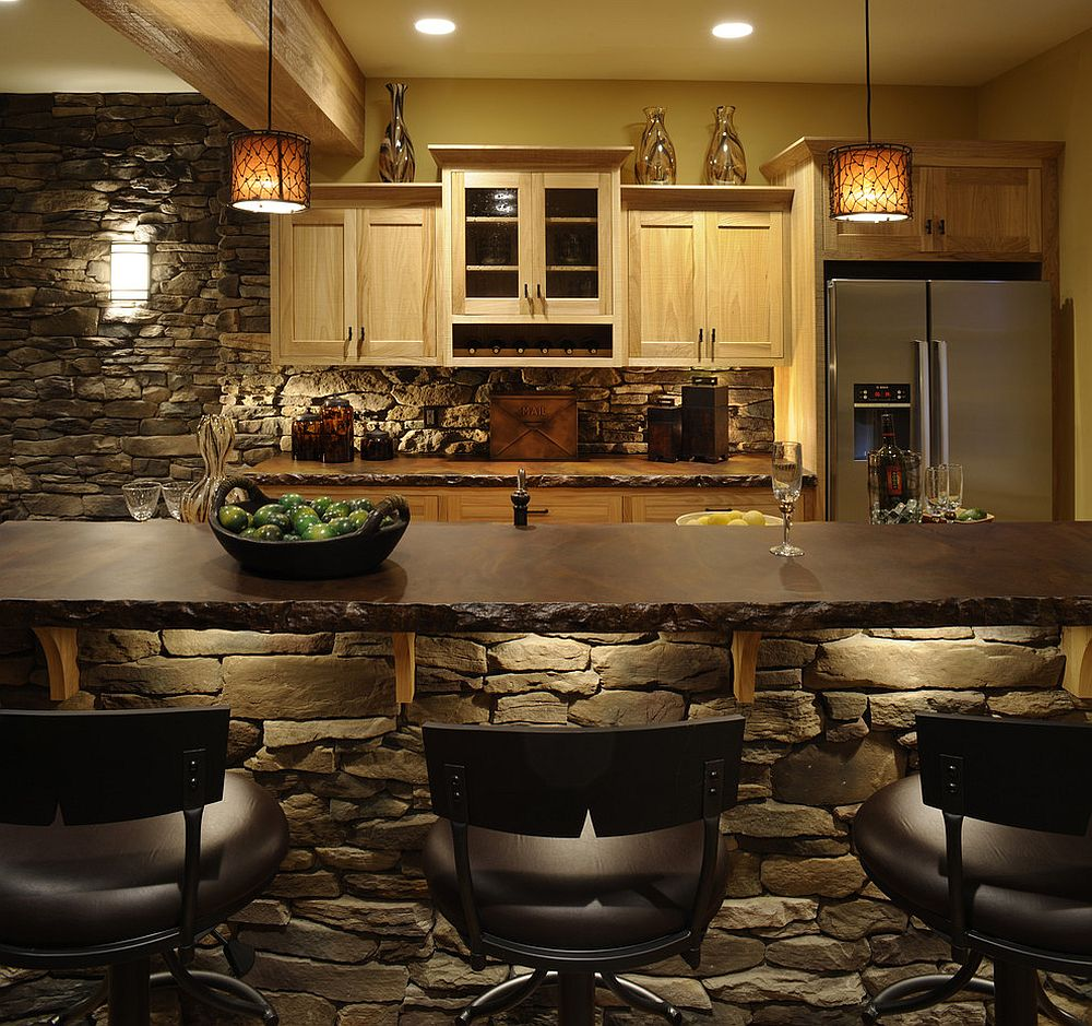 Rustic kitchen covered entirely in stone with lighting that adds to the ambiance