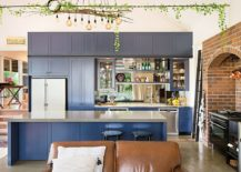 Shaker-style-cabinets-in-deep-blue-steal-the-show-inside-this-eclectic-gallery-kitchen-217x155