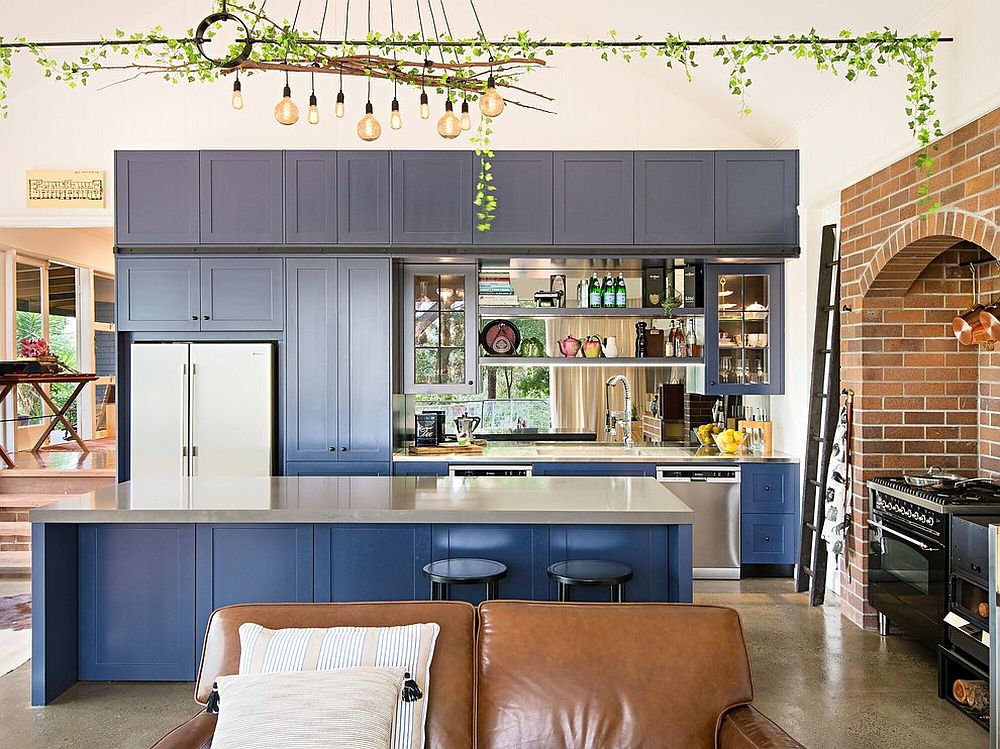 Shaker style cabinets in deep blue steal the show inside this eclectic gallery kitchen