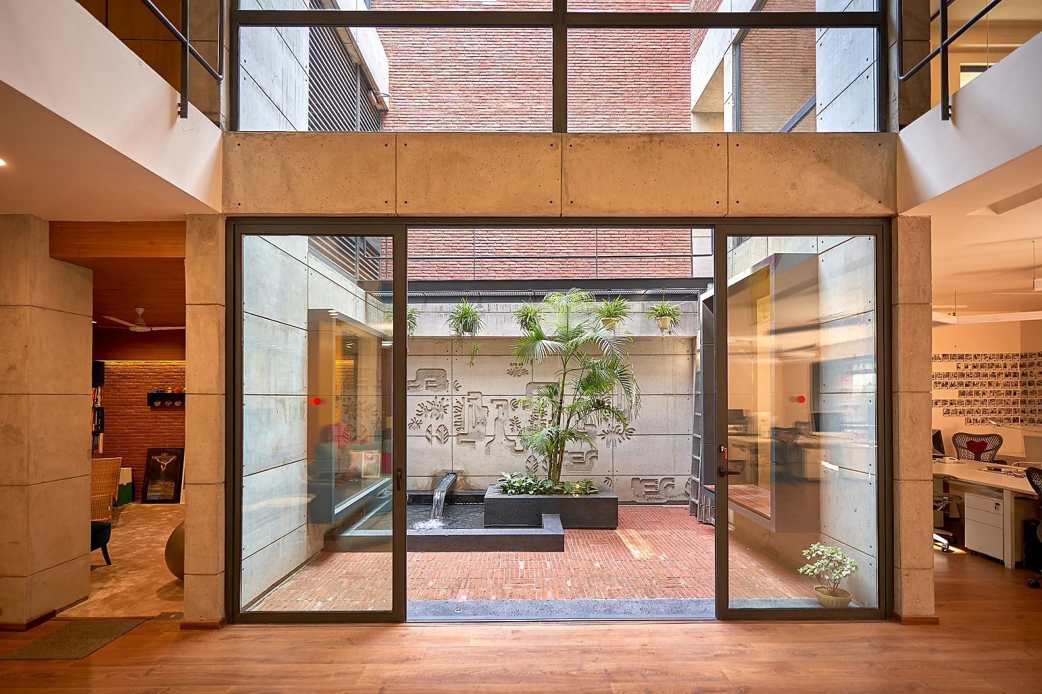 Sliding glass doors connect the interior with the beautiful modern courtyard