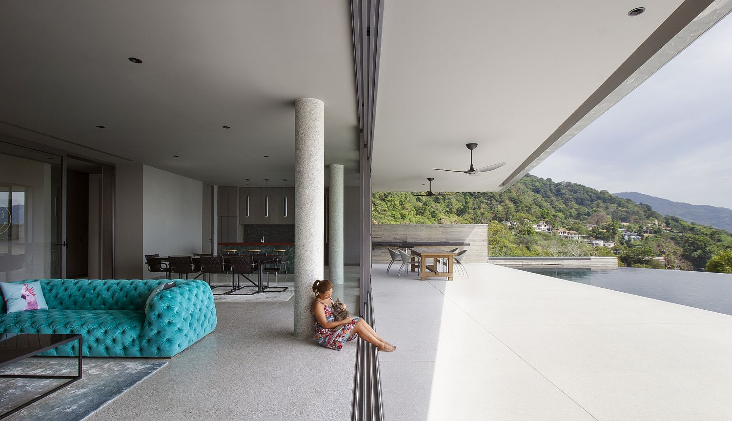 Sliding glass doors delineate the living area from the deck and pool easily