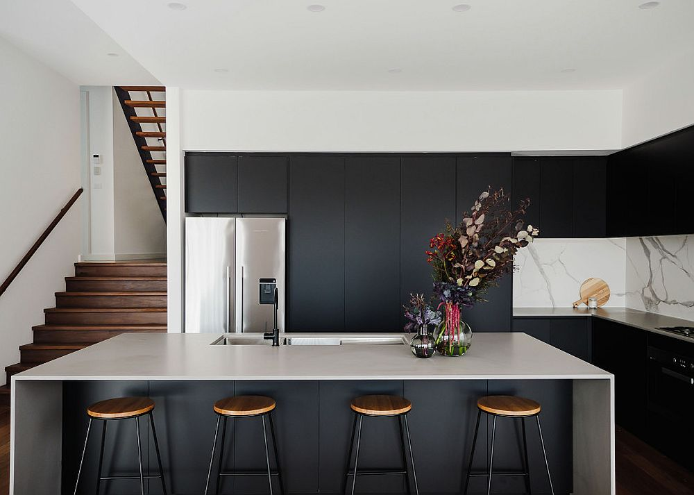 Slim-stools-for-the-kitchen-in-black-with-marble-backsplash