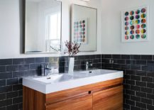 Small-and-space-savvy-bathroom-with-a-tiny-double-floating-vanity-in-wood-217x155