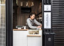 Small-cube-design-of-the-coffee-shop-gives-it-space-savyy-appeal-217x155