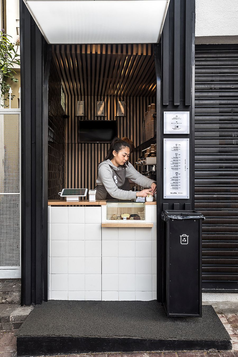 Small cube design of the coffee shop gives it space-savyy appeal