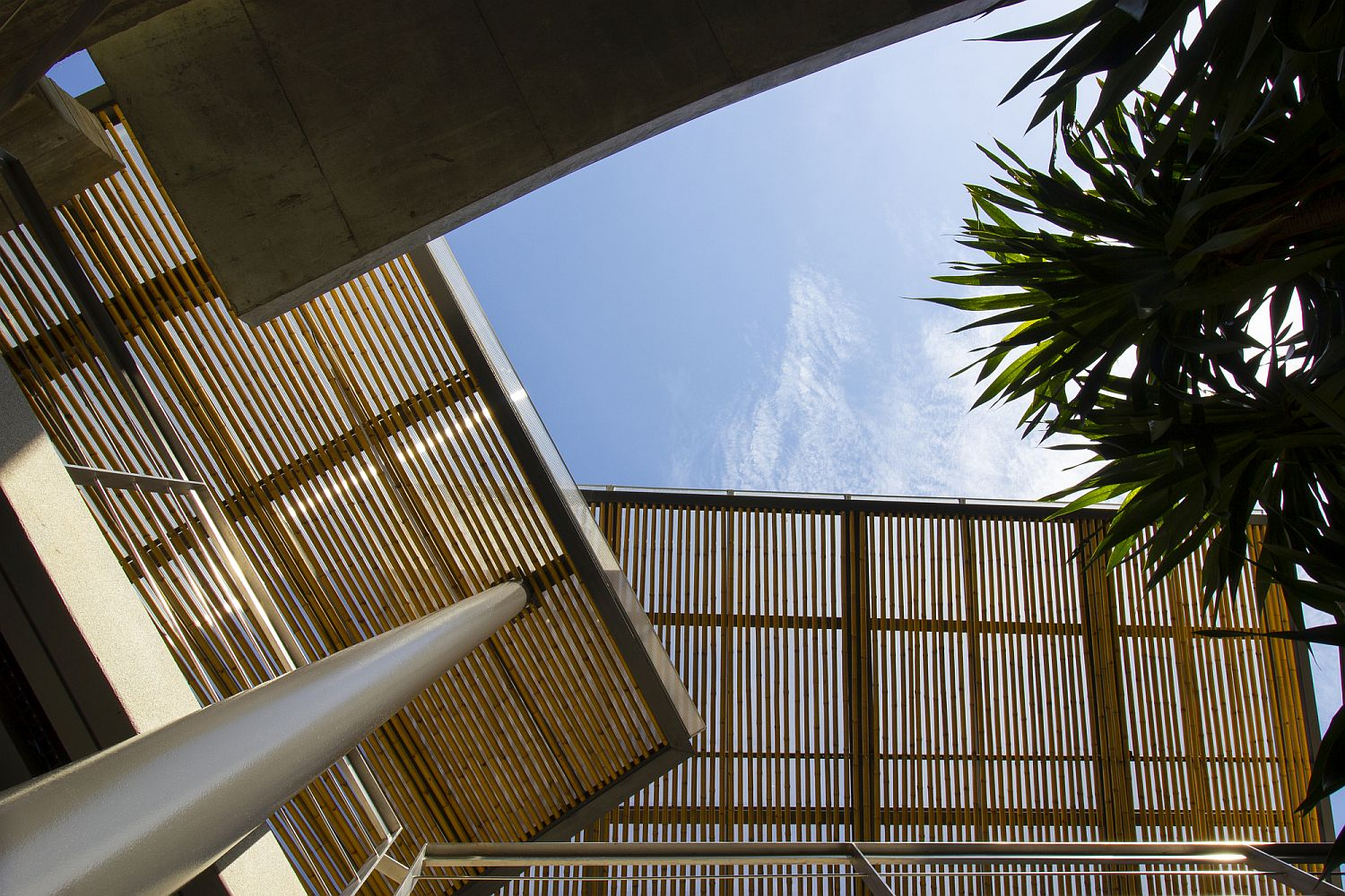 Smart placement of moving bamboo shades inside the Kalim Beach House