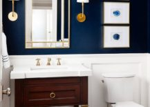 Sophisticated-bathroom-in-dark-blue-and-white-with-smart-art-pieces-that-reflect-its-style-217x155