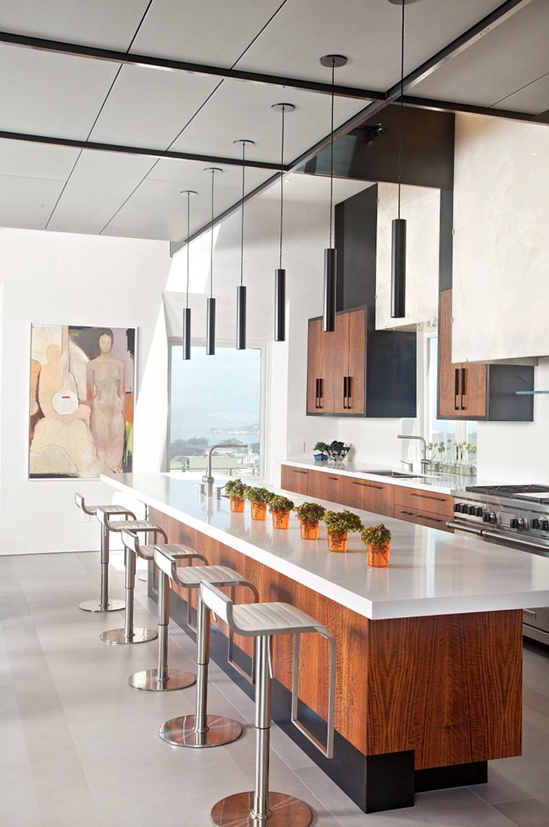 Spacious kitchen island with polished coutertop and a breakfast bar for entre family