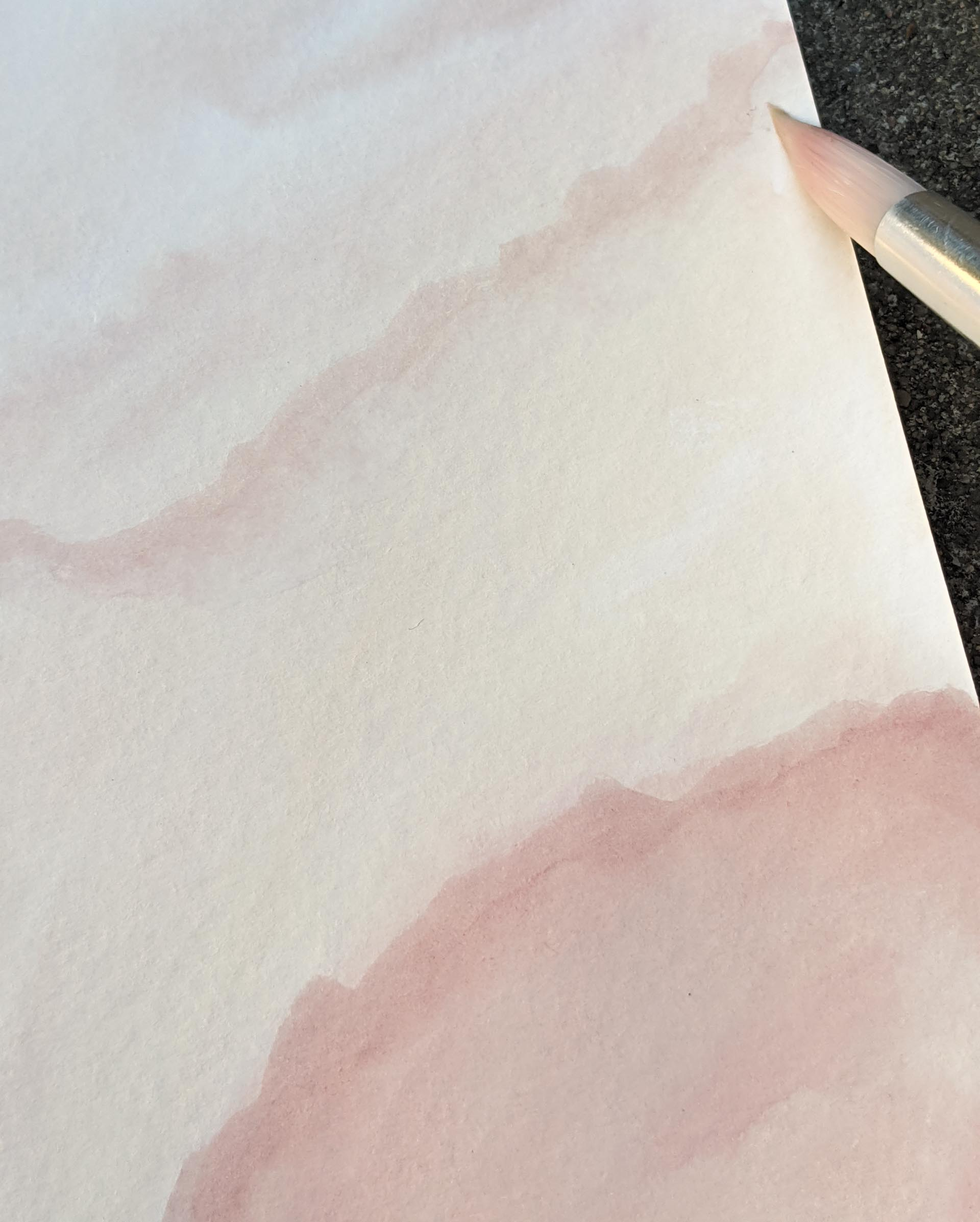 Spreading the paint to the edges of the paper