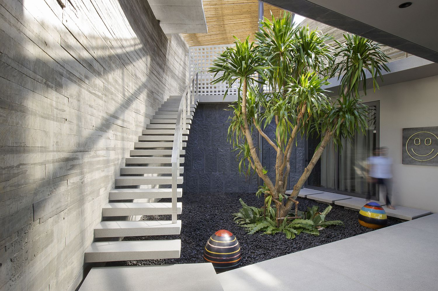 Staircase leading to the living areas and courtyard on the lower level