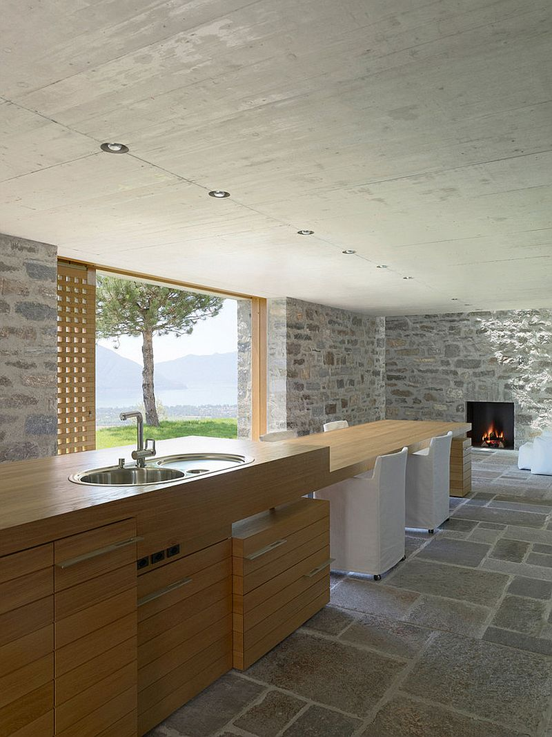 Stone concrete and wood combined in the kitchen to offer ample textural contrast