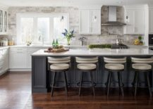 Stone-wall-backdrop-for-the-kitchen-gives-it-a-modern-rustic-appeal-217x155