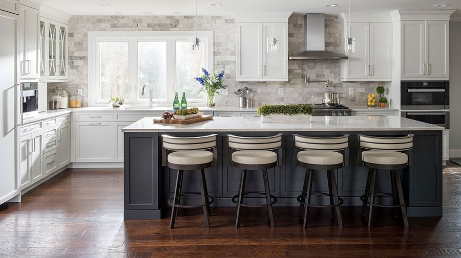 Stone wall backdrop for the kitchen gives it a modern-rustic appeal
