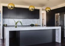 Striking-pendants-bring-metallic-accent-to-the-kitchen-in-black-217x155