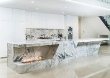 Stunning-stone-kitchen-island-with-a-fireplace-is-sizzling-hot-and-eye-catching-217x155
