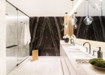 Stunning-use-of-dark-natural-stone-in-the-contemporary-bathrom-with-minimal-appeal-217x155