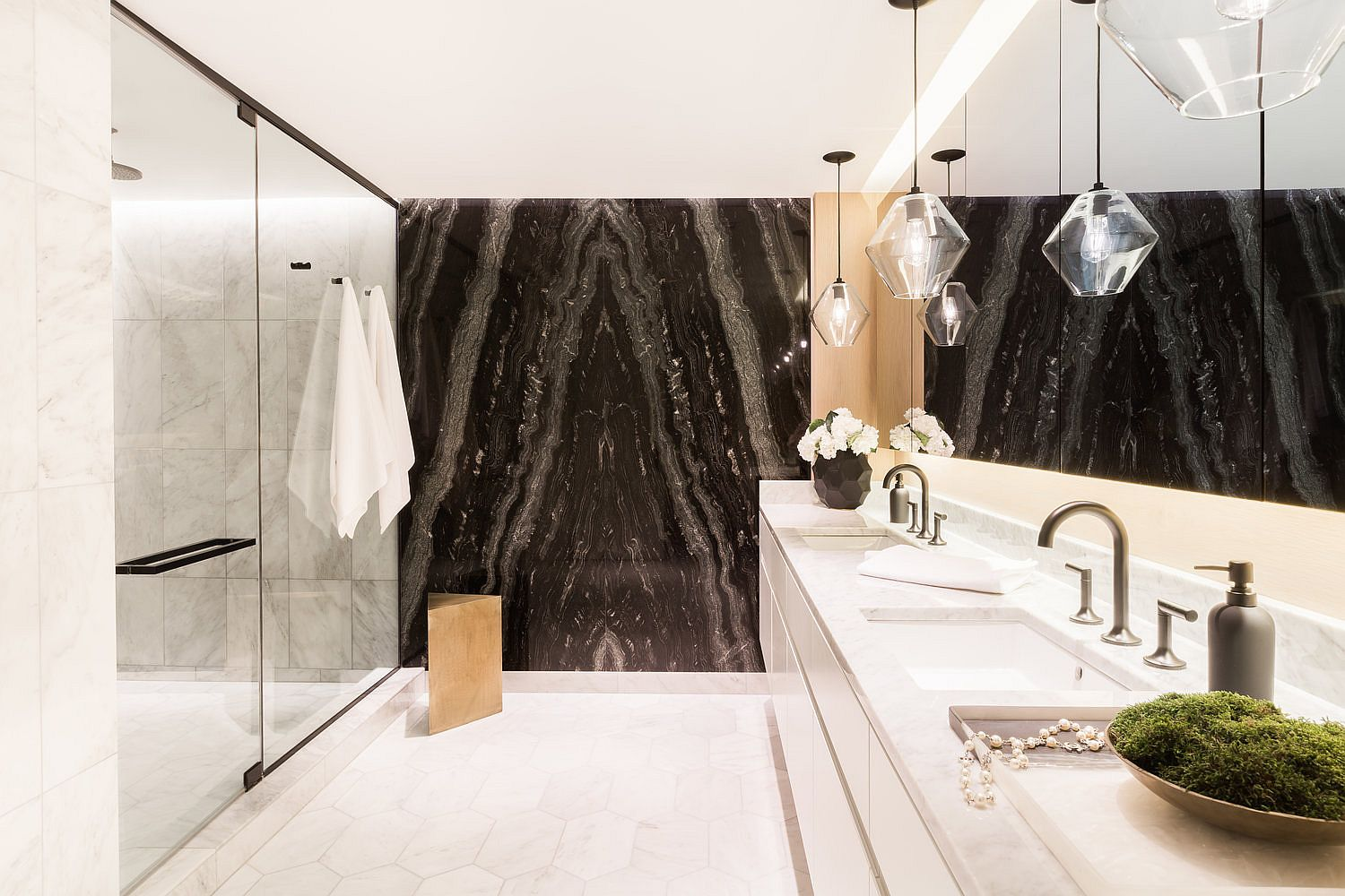 Stunning use of dark natural stone in the contemporary bathrom with minimal appeal