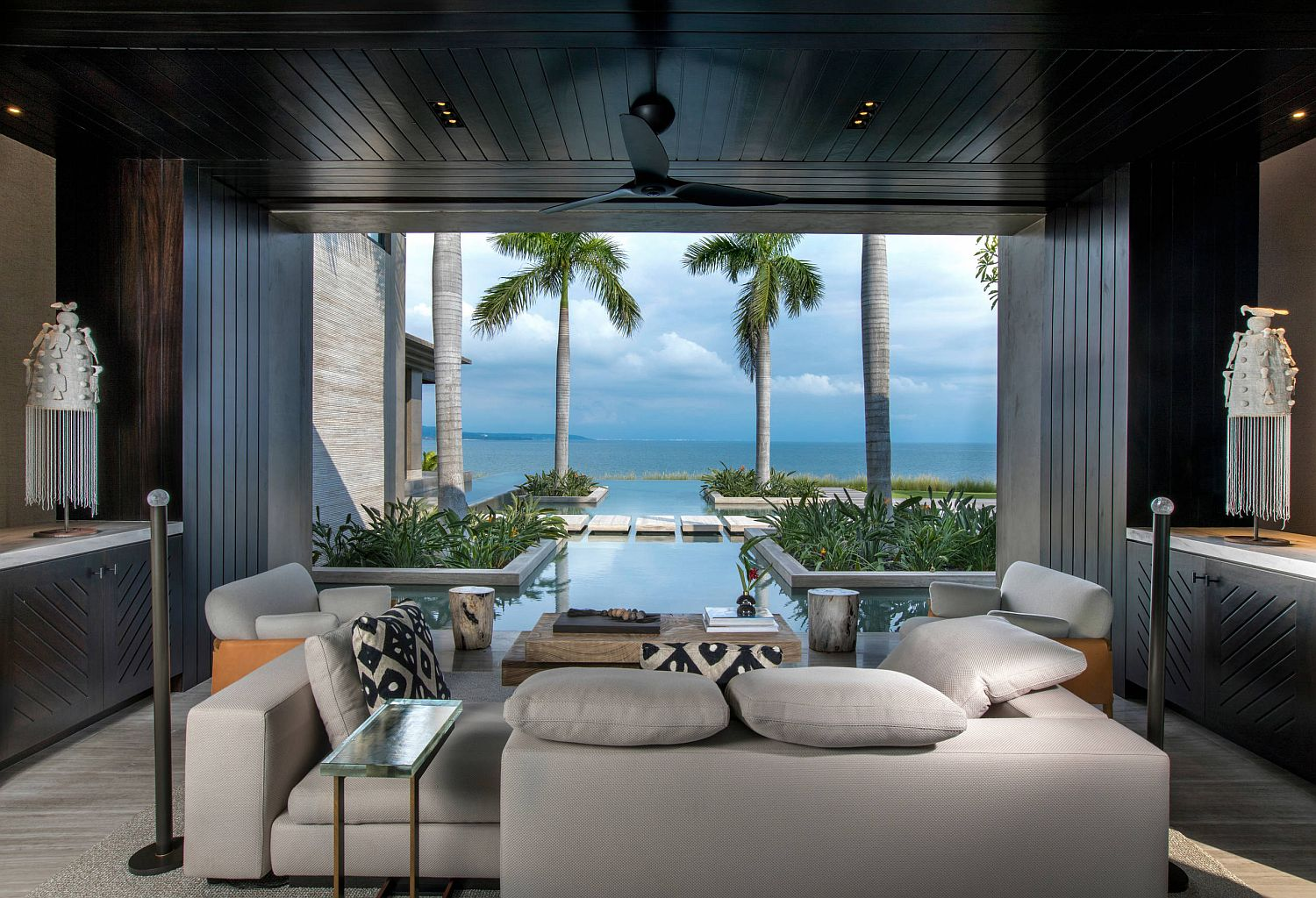 Stunning views, pool and the outdoors become a part of the lovely living room