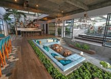 Sunken-living-room-for-the-spacious-living-area-draped-in-concrete-217x155