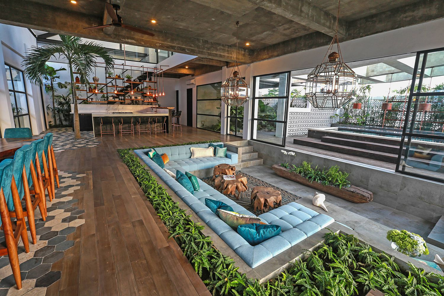 Sunken-living-room-for-the-spacious-living-area-draped-in-concrete