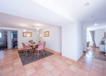 Tiles-and-chairs-usher-pink-into-this-open-plan-dining-area-connected-with-the-living-space-217x155