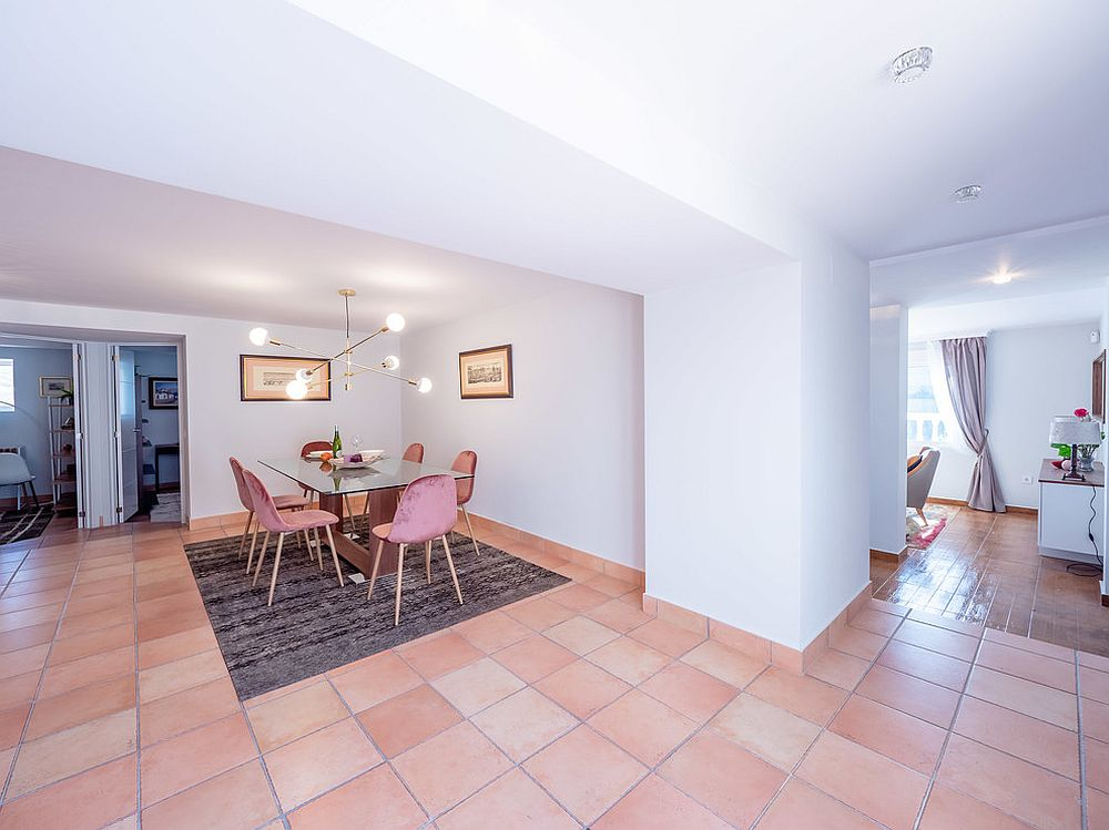 Tiles and chairs usher pink into this open plan dining area connected with the living space