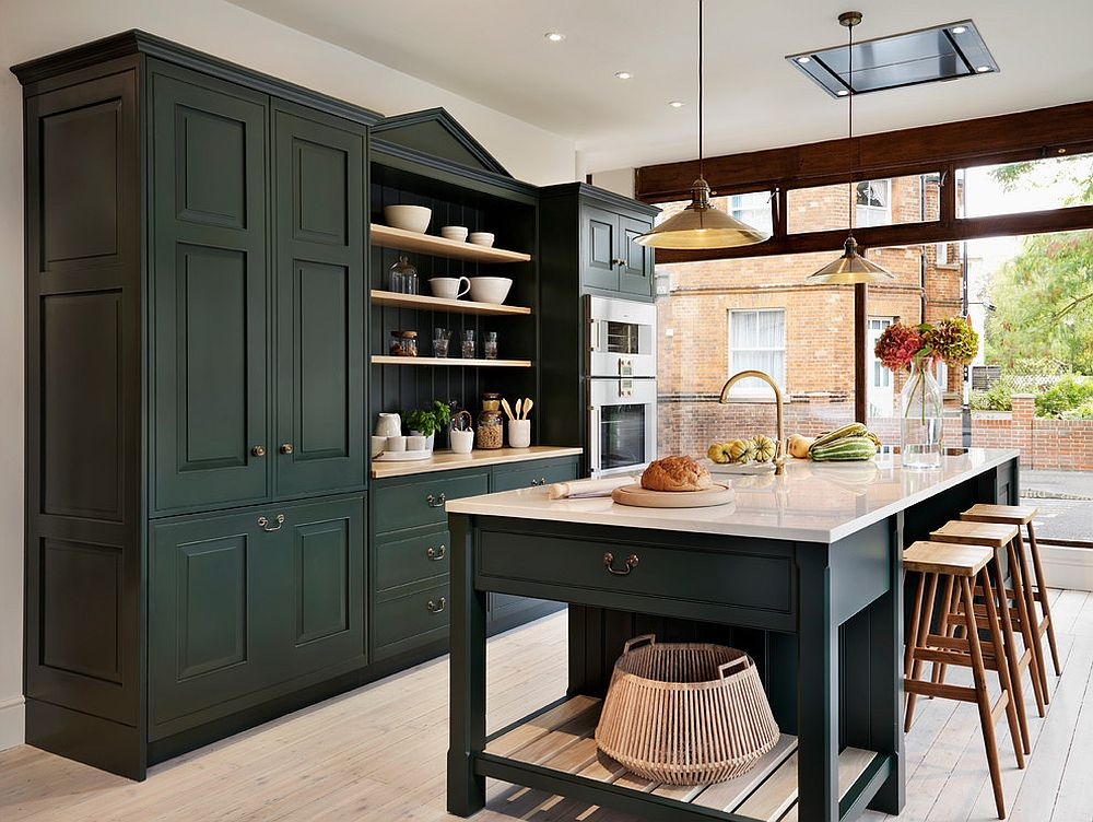 Traditional kitchen with dark cabinets and ample naural light