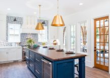 Transitional-kitchen-in-white-and-blue-with-bold-metallic-pendants-217x155