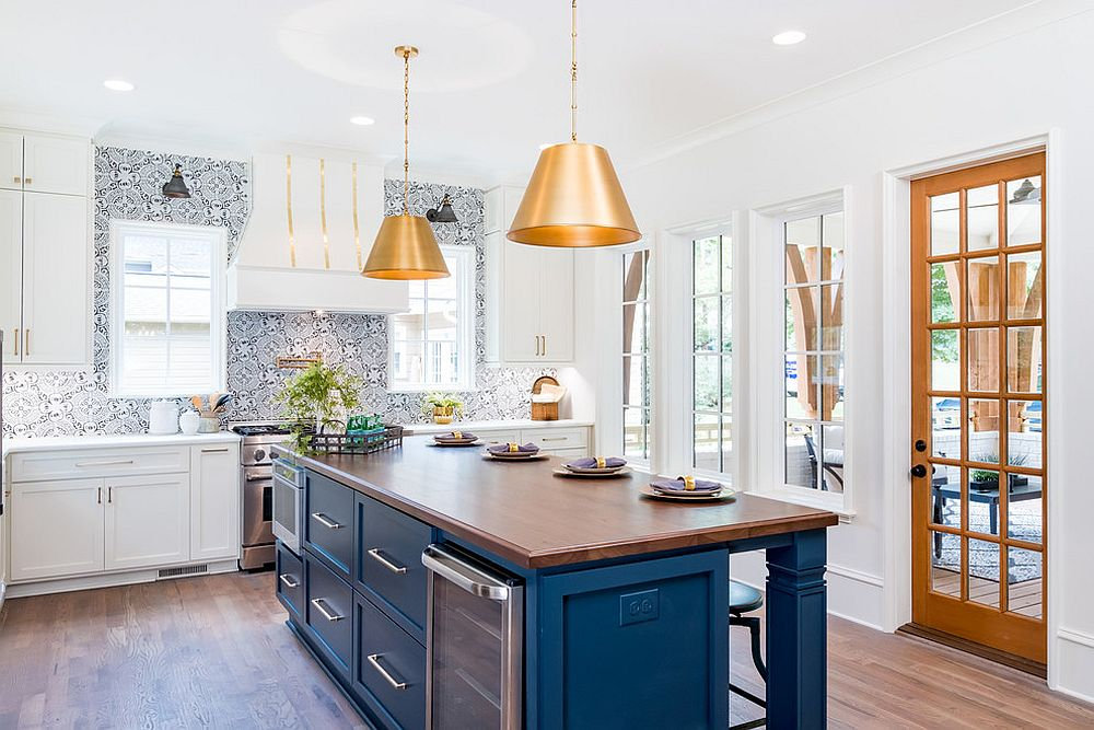 Transitional-kitchen-in-white-and-blue-with-bold-metallic-pendants