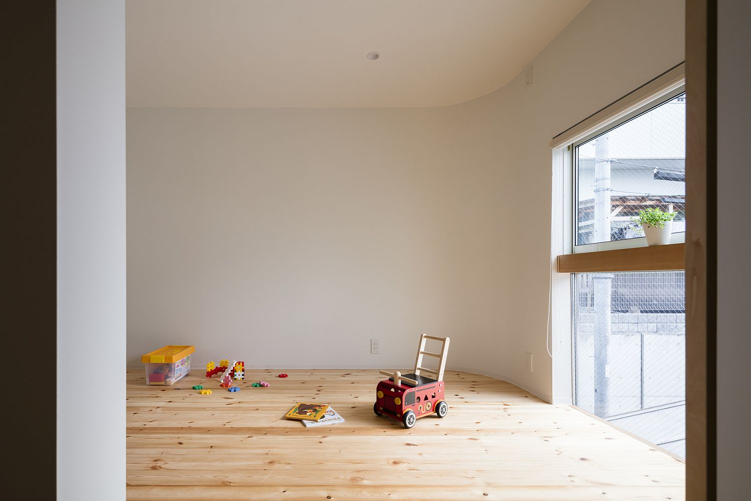 Upper level play room of the Melt House with ample natural light